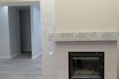 Штукатурка Элеганза перламутровый крем стен хорошо смотрится и на кухне с барной стойкой и в холле с камином.Eleganza с шелковыми переливами и перламутровым сиянием.